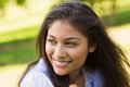 Close-up Of A Smiling Woman Looking Away In Park Royalty Free Stock Image - 37822476