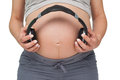 Pregnant Woman Holding Headphones Over Bump Stock Photos - 37826623