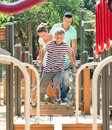 Couple Together With Teenager Overcomes The Obstacle Course Stock Photos - 37840713