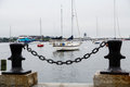 Black Chain On Bollards With Boston Harbor In Backgrounds Royalty Free Stock Photos - 37846148
