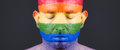 Gay Flag Painted On The Face Of A Man. Royalty Free Stock Photography - 37863607