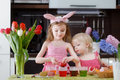 Two Little Sisters Painting Easter Eggs Stock Photo - 37886320