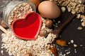A Healthy Dry Oat Meal With Nut And Red Heart In A Wooden Spoon Stock Images - 37891964