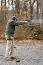 Man Firing Pistol Stock Photos - 3792363