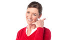 Smiling Woman Making A Call Me Gesture Stock Photos - 37921363