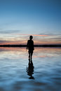 Concept Image Of Young Boy Walking On Water In Sunset Landscape Stock Images - 37944424