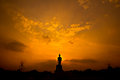 Silhouette Buddha Statue In The Sunset Royalty Free Stock Images - 37948859