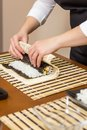 Hands Of Woman Chef Rolling Up A Japanese Sushi Stock Image - 37949471