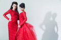 Two Brunette Girlfriends Wearing Red Dresses Stock Image - 37952551