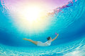Underwater Swimming With Flowers Stock Image - 37960271