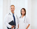 Two Doctors With Stethoscopes Royalty Free Stock Images - 37970059