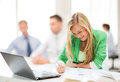 Attractive Businesswoman Taking Notes In Office Stock Photo - 37974570