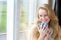Smiling Young Lady Holding Cup Of Tea Royalty Free Stock Photo - 37974705