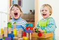 Happy  Siblings Together Playing With Blocks Stock Photo - 37989230