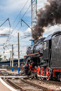 Old Steam Train Is Leaving A Station Royalty Free Stock Photos - 37995208
