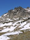 Rocks In The Snowy Mountains Royalty Free Stock Images - 37997189