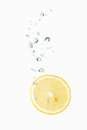 Lemon In Water With Air Bubbles Stock Photography - 38021352