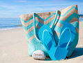 Beach Bag With Flip Flops By The Ocean Stock Image - 38041851