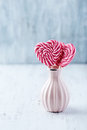 Two Heart-Shaped Lollies In A Small Vase Royalty Free Stock Photography - 38056607