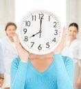 Businesswoman With Clock Over Her Face Royalty Free Stock Photos - 38067678