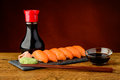 Nigiri Sushi With Salmon, Soy Sauce And Chopsticks Royalty Free Stock Photography - 38082957