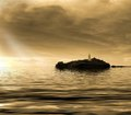 Sunset Over Island Lighthouse Royalty Free Stock Images - 38108089