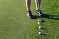 Golfer Putting The Golf Ball Stock Images - 38139434