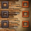 Frames On Wooden Finished Wall Royalty Free Stock Images - 38184479