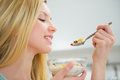 Young Woman Eating Healthy Breakfast Stock Images - 38198684