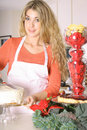 Woman In The Kitchen Frosting A Cake Stock Photos - 3826743