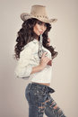 Beautiful Brunette Cowgirl. Royalty Free Stock Image - 38210156