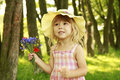 Beautiful Little Girl On Nature With A Bouquet Of Flowers Stock Image - 38234941