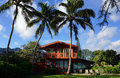 Red Two Story Beach House With Tall Coconut Trees Stock Photos - 38251863