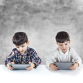Children Playing With A Digital Tablet Royalty Free Stock Image - 38276596