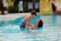 Mom And Son In The Pool Royalty Free Stock Image - 38296376