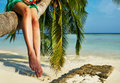 Woman Sitting On A Palm Tree At Tropical Beach Royalty Free Stock Photography - 38297227