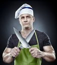 Menacing Man Cook Holding Two Sharp Knives Royalty Free Stock Images - 38308849