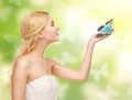 Woman With Butterfly In Hand Royalty Free Stock Photos - 38312888