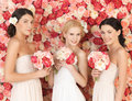 Three Women With Background Full Of Roses Royalty Free Stock Photos - 38317678
