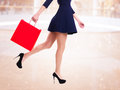 Woman In High Heels With Red Shopping Bag. Royalty Free Stock Image - 38319536
