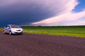 Car Running Storm Clouds Royalty Free Stock Photography - 38324577