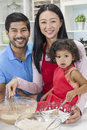 Asian Chinese Family Cooking In Home Kitchen Stock Photo - 38354820