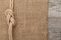 Ship Rope On Wood And Burlap Texture Background Stock Images - 38358194