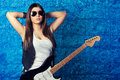 Beautiful Young Woman Wearing Sunglasses With Guitar Stock Image - 38369021