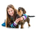 Happy Little Girl With Her ​​dachshund Stock Photo - 38371210