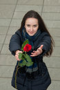Nice Girl Wants To Compliment With Red Rose Stock Photos - 38374003