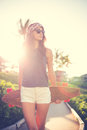 Hipster Girl With Skate Board Wearing Sunglasses Royalty Free Stock Images - 38383839