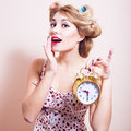 Happy Woman Showing Golden Alarm Clock Portrait Royalty Free Stock Photo - 38396285