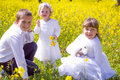 Children In The Field With Pet Rabbit Stock Photography - 38403882