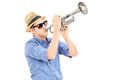 Young Male Musician Blowing Into A Trumpet Royalty Free Stock Images - 38414309